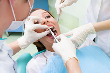 Female patient in dentist office getting tooth  procedure