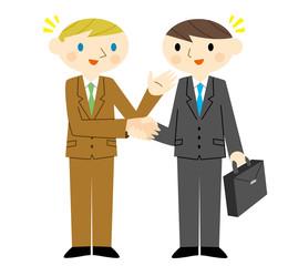 握手する日本人と外国人の会社員