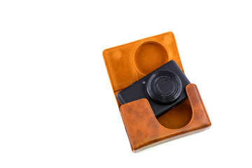 camera with a leather case isolated on white