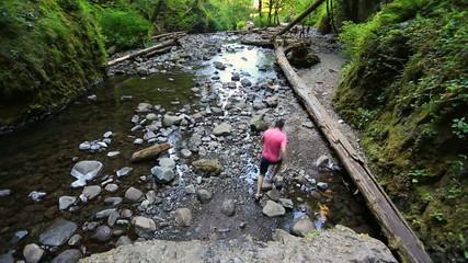 Glide Cam Male Walking Through Creek Sequence
