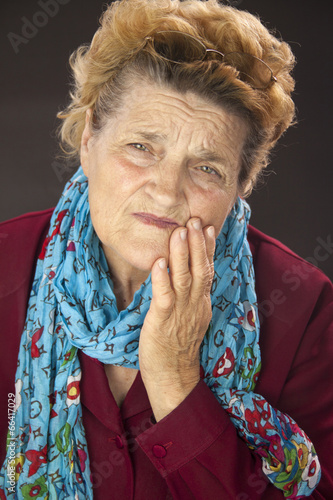 Senior woman having tooth ache