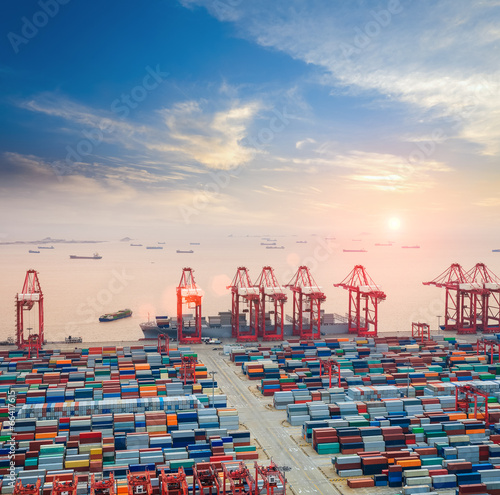 Leinwanddruck Bild modern container terminal at dusk