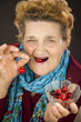 Senior woman eating cherries