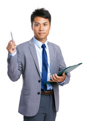Asian businessman with clipboard and pen point up