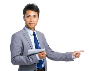 Asian businessman with tablet and finger point aside