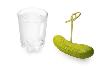 Glass of vodka and pickle on a skewer