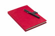 Blank red hardcover notebook with pen isolated