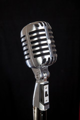 vintage microphone over black background