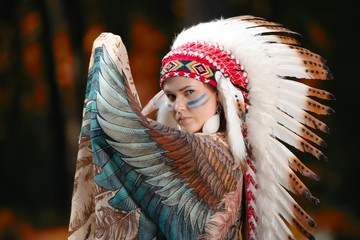 Young woman in war bonnet headdress of American Indian