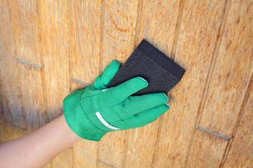 Plank, wood preparation with sanding sponge block for varnishing