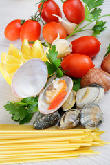raw seafood called fasolari with mussels and clams