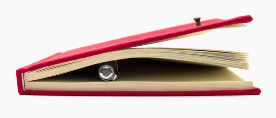red notebook and pen isolate