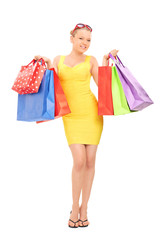 Woman holding a bunch of shopping bags