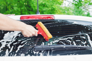 Cleaning the back windshield.