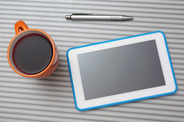 top view of  tablet pc   and cup of tea