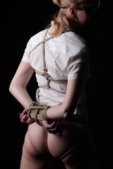 Young woman with shibari