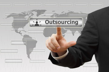 Outsourcing. Businessman pressing Outsourcing virtual button