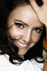 Beautiful young woman with long brown hair. Pretty model smiling