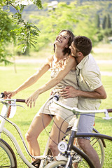 Couple having a bicycles ride into the nature