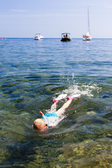 little girl snorkeling in Mediterranean Sea