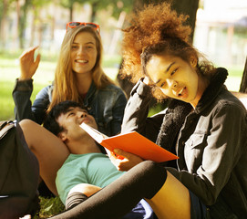 group of students on grass, prepaing to exam outside