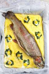 trout salmon baked with spinach ane quail eggs