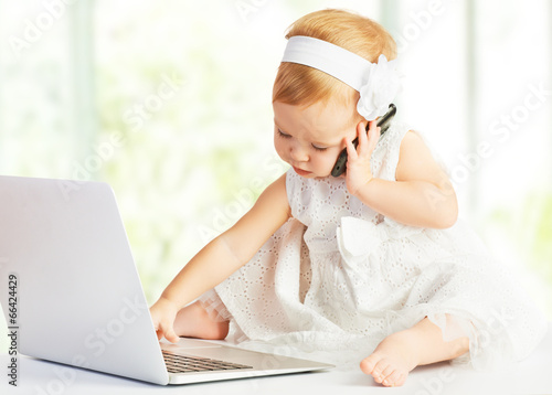 baby girl at  laptop computer, mobile phone