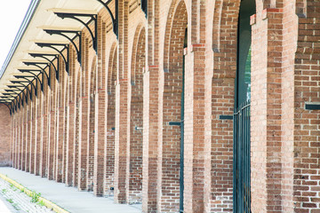 Rows of Arched Doors in a Brick Building