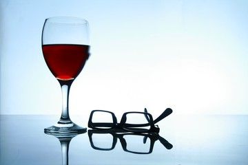 Alcoholic Drink and a pair of eyeglasses