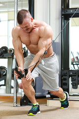 Gym. Handsome man during workout