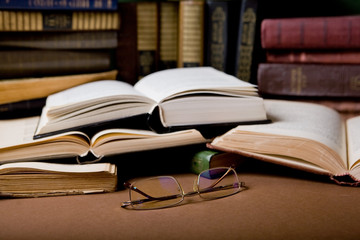 glasses and open books