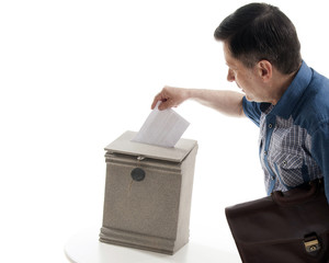 Man throws a letter in the mailbox