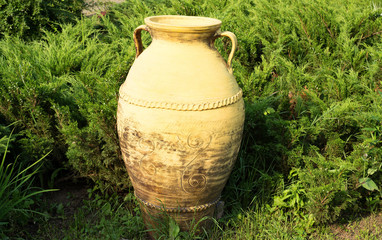 Ceramic amphora in the grass