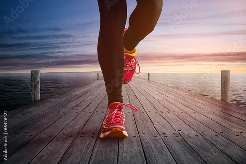 canvas print picture Jogging on a Jetty
