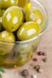 green olives in a glass bowl