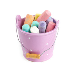 colorful chalks in a bucket isolated on white
