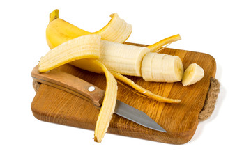 banana on cutting board with knife