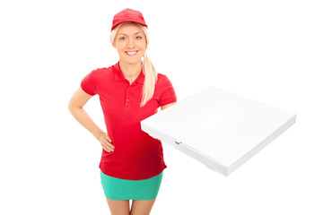 Delivery girl holding a box of pizza
