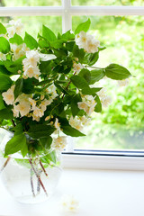 bouquet of jasmine on window-sill