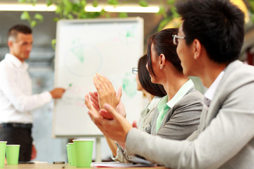 Business people applauding in a meeting. Business concept.