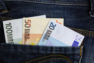 Euro banknotes in jeans pocket