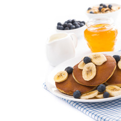 pancakes with banana and blueberries, yogurt and muesli, isolate