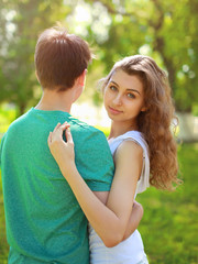 Summer portrait young charming girl and boyfriend