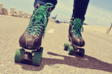closeup of a young man roller skating, with a cross-processed ef