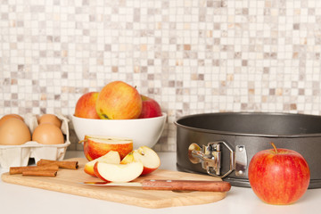 Ingredients and tools to make a apple pie
