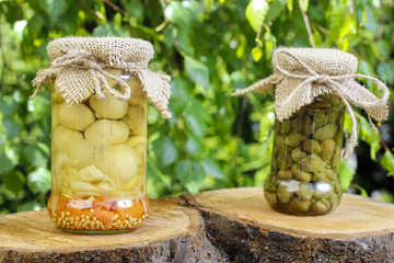 Pickled capers and mushrooms in glass jars