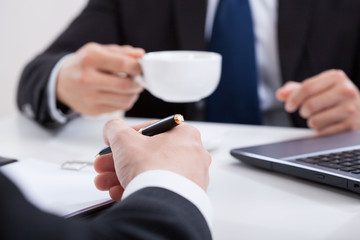 Man drinking coffee on a meeting