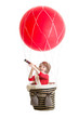 child on hot air balloon watching through spyglass