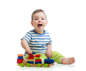 little cheerful child with block toys