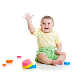 Funny baby playing with toys isolated